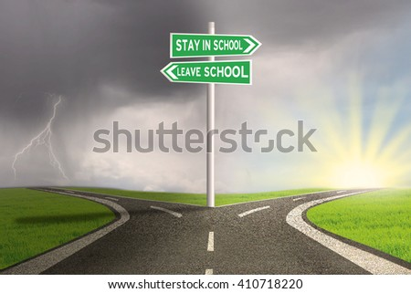 Image of empty highway with two choices on the signpost to stay or leave school