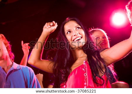 Image of energetic girl dancing on background of her friends - stock photo