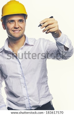 Image of engineer posing in studio - stock photo