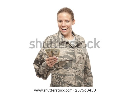Image of excited female soldier with money against white background - stock photo