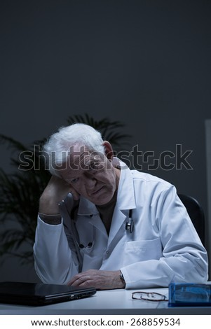 Image of experienced doctor suffering for depression - stock photo