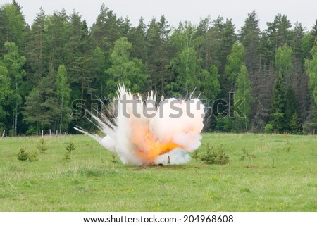 Image of explosion on field during military actions - stock photo