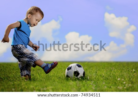 Image of family, mother and son playing ball in the park. - stock photo