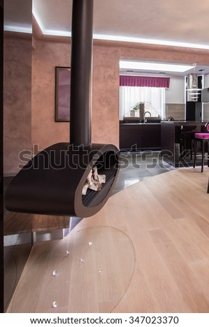 Image of fashionable solid fireplace in spacious living room - stock photo