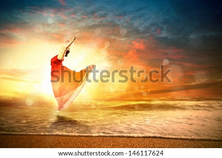 Image of female ballet dancer against sunset background soaring above water waves - stock photo