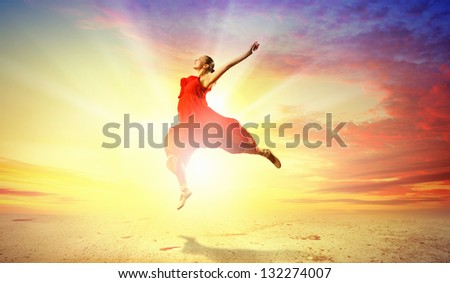 Image of female ballet dancing on coast against sunset background