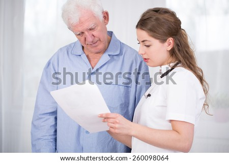 Image of female doctor discussing with patient - stock photo