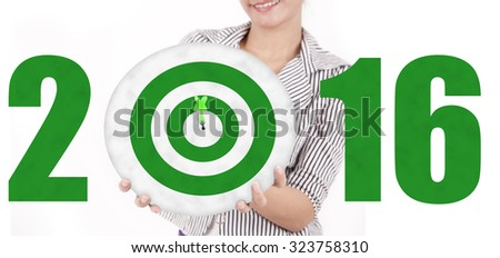 Image of female entrepreneur showing a green dartboard with numbers 2016. Isolated on white