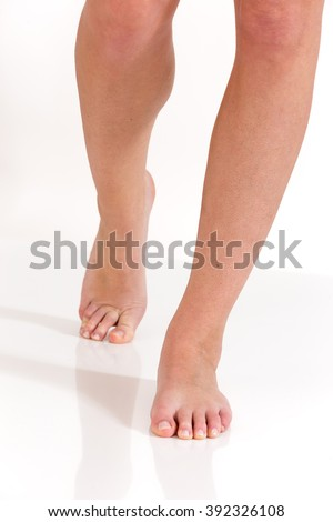 image of Female feet walking front view