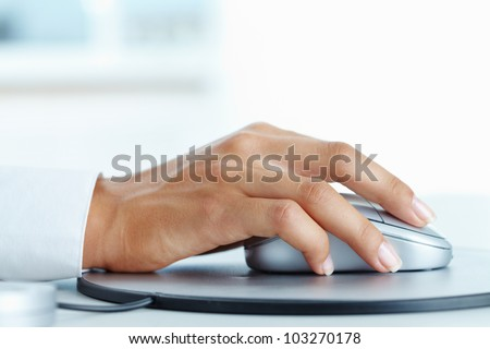 Image of female hand clicking computer mouse - stock photo