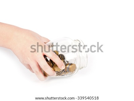 image of female hand putting a coin into glass bottle, saving concept