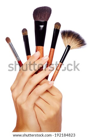 Image of female hand with beauty tools in isolation