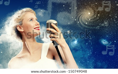 Image of female singer holding microphone against illustration background - stock photo