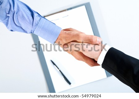 Image of final of deal over paper with pen - stock photo