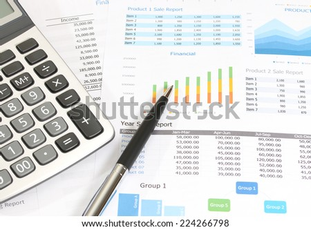 image of financial report with pen and calculator at the office