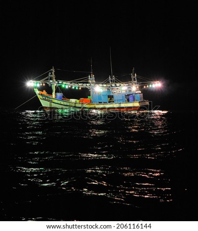 Image of Fishing boat in the open sea - stock photo