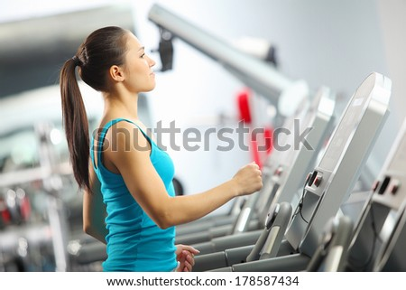 Image of fitness girl running on treadmill