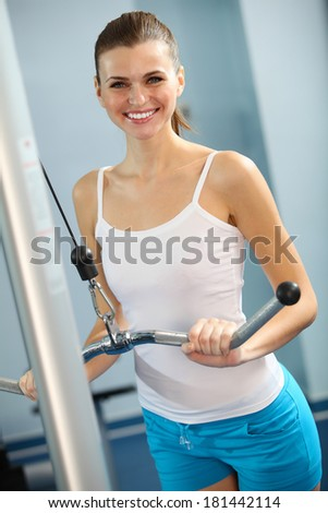 Image of fitness woman in gym working out - stock photo