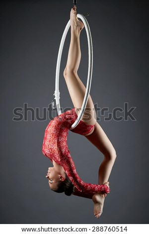 Image of flexible dance performer on aerial hoop - stock photo