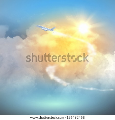 Image of flying airplane in sky with clouds at background