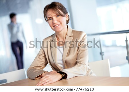 Image of formal businesswoman looking at camera - stock photo