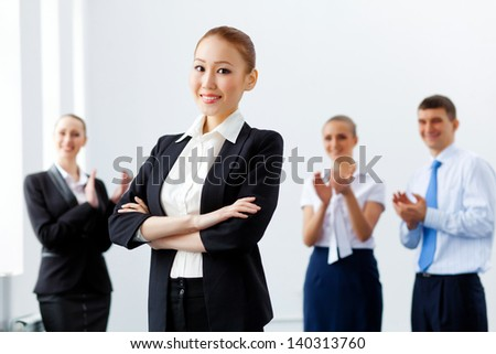 Image of four pretty young businesswomen standing in row - stock photo