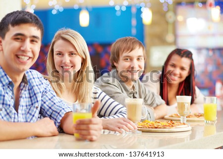 Image of four teenage friends sitting in cafe