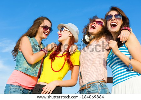 Image of four young attractive girls having fun outdoors - stock photo