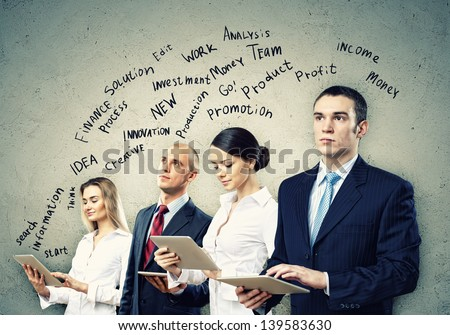 Image of four young businesspeople. Teamwork concept - stock photo