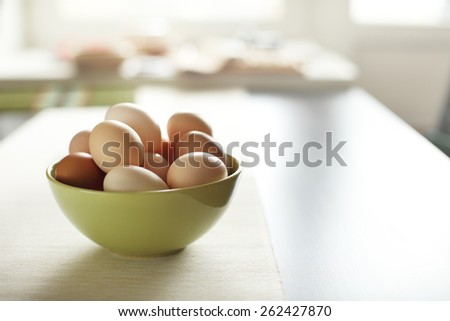 Image of fresh brown chicken eggs in a plate - stock photo