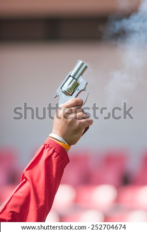 Image of fried pistol gun in red shirt man hand - stock photo
