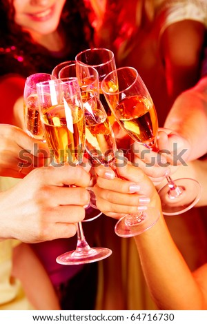 Image of friends hands with crystal glasses full of champagne - stock photo