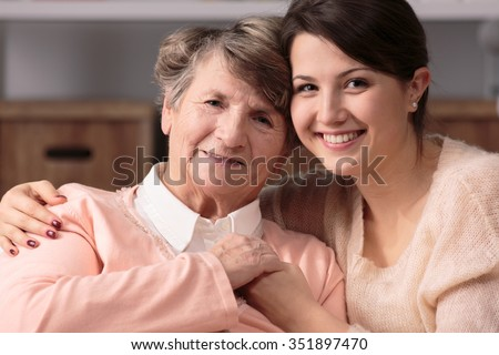 Image of friendship between happy carer and senior woman - stock photo