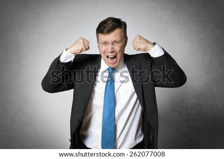 Image of frustrated crying business man in dark suit - stock photo