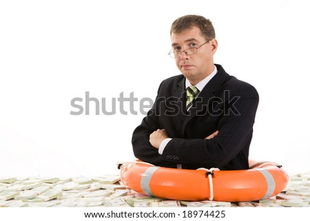 Image of frustrated man with life buoy surrounded by dollars - stock photo