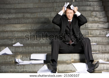 Image of frustrated professional with his eyes closed in grief during crisis - stock photo