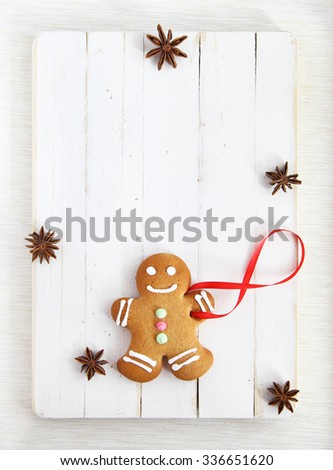 Image of Gingerbread man on white vintage cutting board with copyspace - stock photo