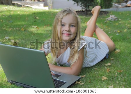 Image of girl with laptop in summer