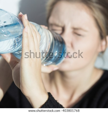 Image of girl with water during starvation diet - stock photo