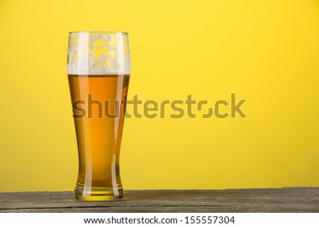 image of glass of beer over orange background - stock photo