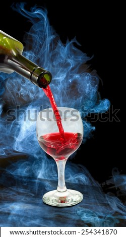 image of glasses and bottles of wine on smoke background  closeup - stock photo