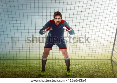 Image of goalkeeper in front of goalpost - stock photo