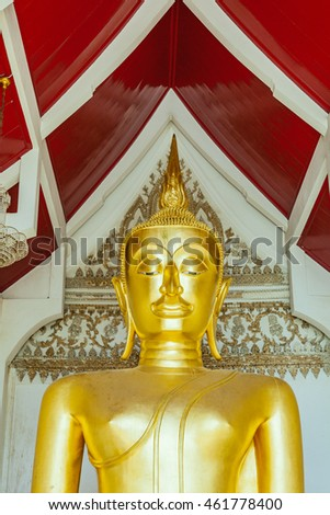 Image of gold buddha statue in thai temple.