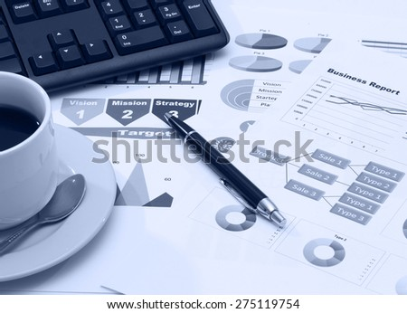 image of graphics for business report with pen black coffee and keyboard