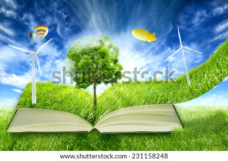 image of green micro world, book covered with green grass wind energy turbines installed. Sustainable source of electricity, power supply concept. Eco, environmentally friendly technology approach - stock photo