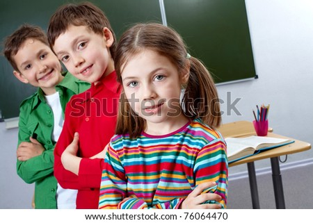 Image of group classmates with leader in front - stock photo