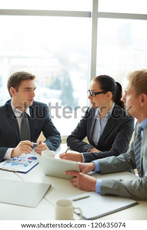 Image of group of employees planning work at meeting - stock photo