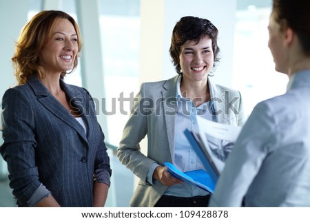 Image of group of happy businesswomen interacting at meeting - stock photo