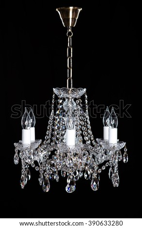 Image of grunge dark room interior with chandelier. Chrystal chandelier close-up. Luxury Glass Chandelier on white background. - stock photo