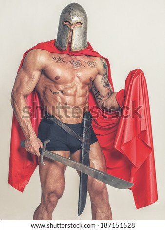 Image of half naked warrior with a grin on face - stock photo